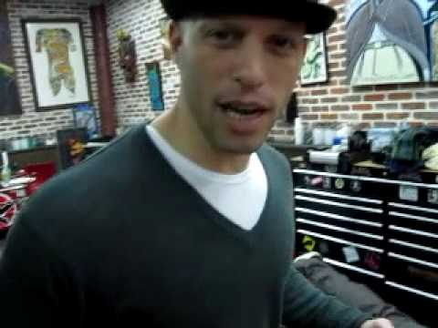 Chris Nunez tattooing a dragon in Miami Beach tattoo shop with Ami James