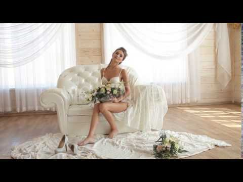 Sexy Model In White Lingerie Sitting On a White Sofa - Stock Footage | VideoHive 14531228