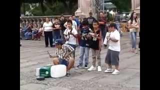 Niños cantando y tocando cumbia en Aguascalientes Jardín de San Marcos 2014