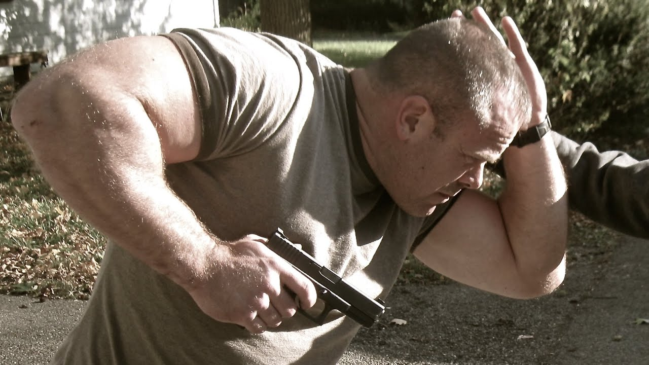 Greg Ellifritz from Active Response Training demonstrating a retention position along with a fending off-side arm.