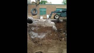 Wrecking ball making money at hospital demoliton