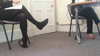 Dangling and heelpopping black flats and tights.