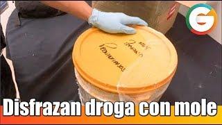 Disfrazan droga con mole