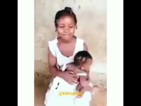 WATCH THE 15 YEARS OLD GIRL BREASTFEEDING HER CHILD, SHE WAS IMPREGNATED MY HER STEP F. WHAT A WORLD ▶1:01