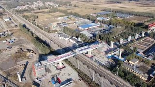 Continuous beams rotate into position on China's railway project