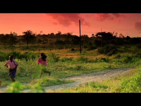 Group of Kenyan students running to school at sunrise.
