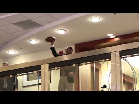 Malcolm Butler surprise with Doug Flutie at Eastern Bank