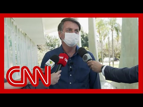 Bolsonaro tests positive for Covid-19 after downplaying virus