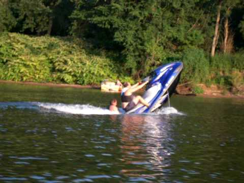 Two Big Guys doing a Wheelie on a Jetski