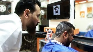 An Egyptian barber is giving fans of Liverpool's Mohamed Salah a br...