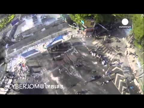 Drone footage  Thailand protesters try to break barricades, police answer with water cannons