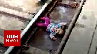 Indian baby's close call with train - BBC News