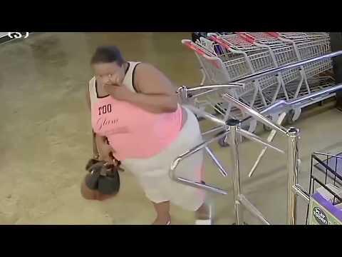 Shreveport LA. Woman On Camera Stealing 18 Bottles Of Liquor.
