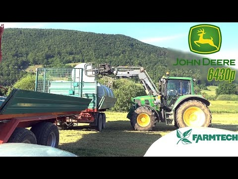John Deere 6430 Premium loading and driving 18 silage bales