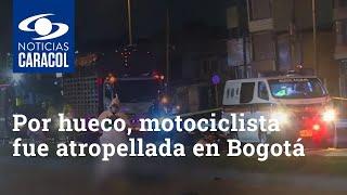 Por un hueco, motociclista fue atropellada por una tractomula en Bogotá