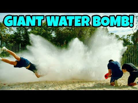 GIANT WATER BOMB Vs. NERF BLASTERS!
