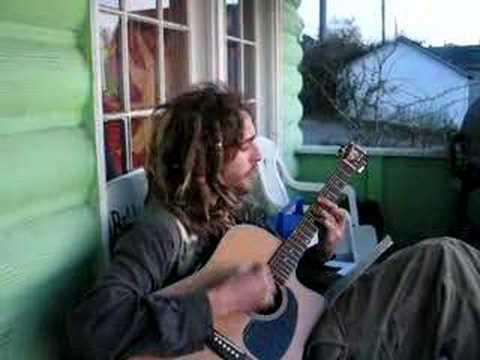 Rasta Andy play a guitar in Bellingham