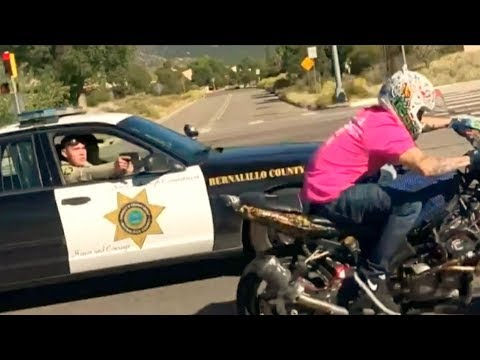 cop points GUN at motorcycle rider.. (is he right?)