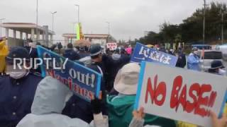 Japan  Scuffles as protesters try to block traffic outside US marine base