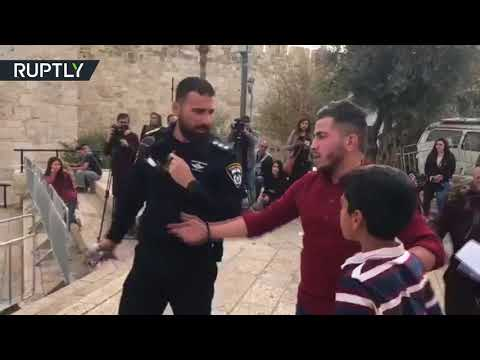Israeli soldier violently rips scarf from neck of Palestinian kid