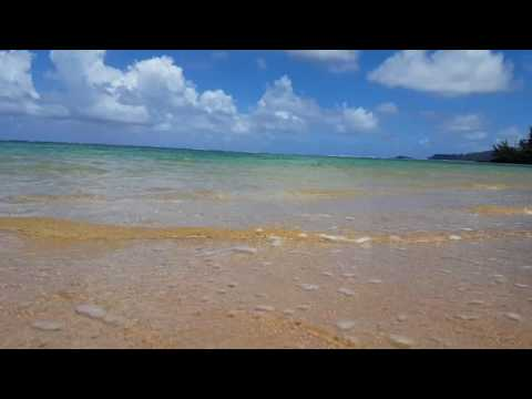 Waves rolling in on Anini beach