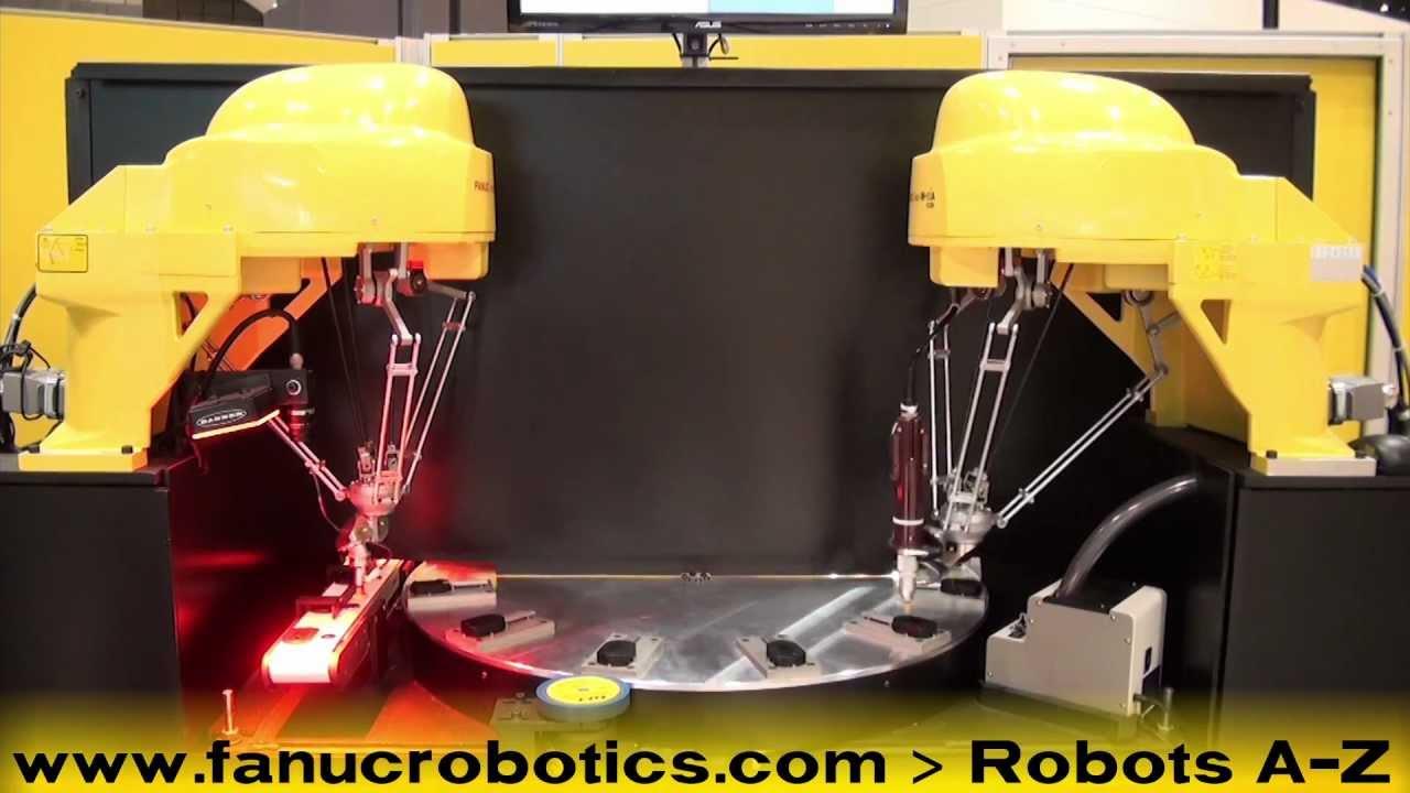 Two FANUC M-1iA 'Spider Robots' Assemble Automotive Key Fobs