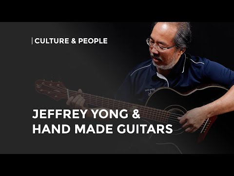 Strumming on Jeffrey Yong's handcrafted guitars