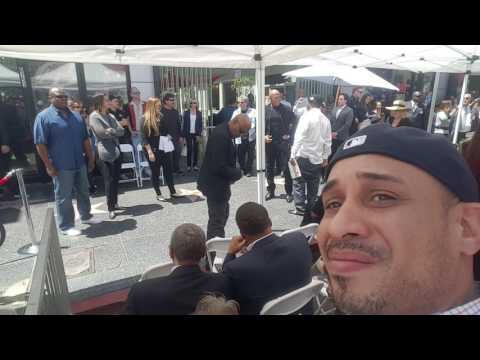 Dr dre leans over for pic at ice cube star event