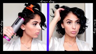 Using a wireless automated curling iron on my short hair