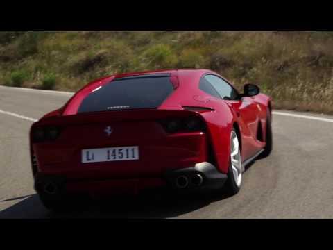 Ferrari 812 Superfast along a winding mountain road near Maranello