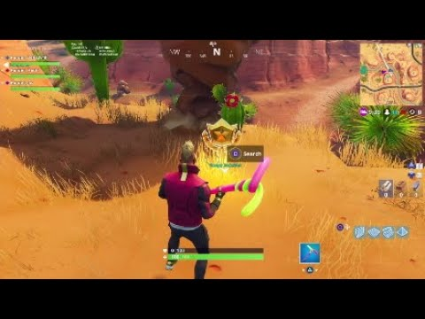 Search Between A Oasis Rock Archway And Dinosaurs Fortnite Season  Challenge