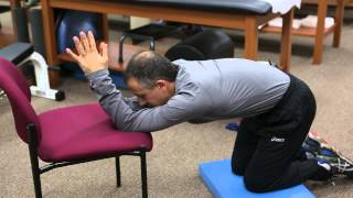 How to Use a Lat Stretch to Relax Tense Back Muscles