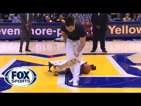 Little tiny dog does acrobat tricks at Villanova-Marquette game