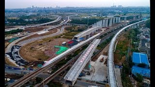 Chinese workers rotate two 7,000-tonne bridge sections into place - Daily News