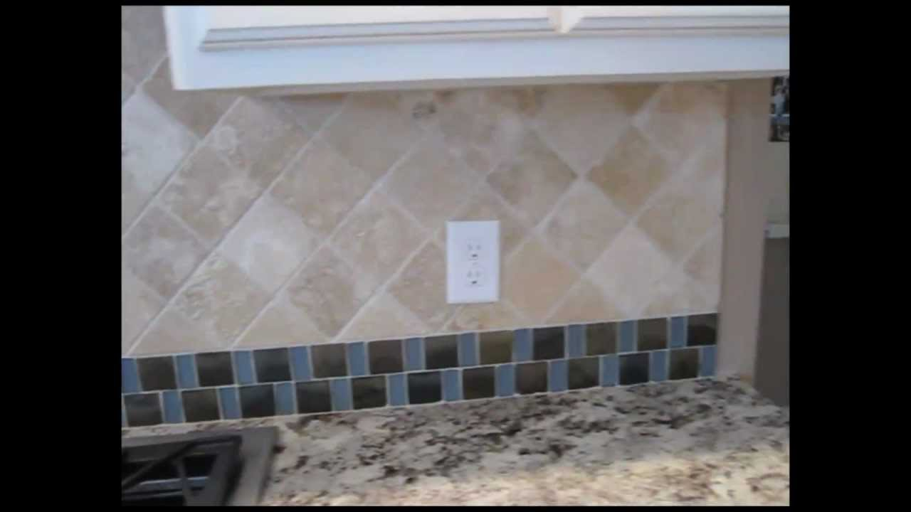 Tumbled marble tile and mosaic glass tile backsplash youtube for Tumbled glass tile