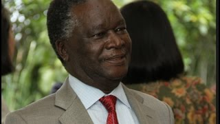 Former Cabinet minister Nicholas Biwott condoles with the family of Mark Too