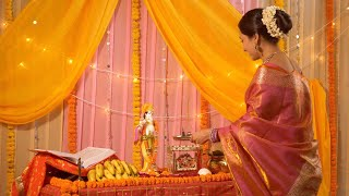 Indian woman performing Pooja, worshiping Lord Krishna - Hindu ritual and customs