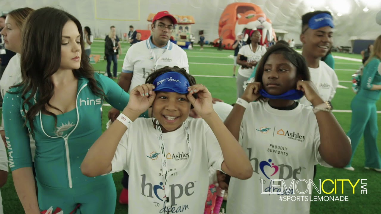3fe725d4 Miami Dolphins and Ashley HomeStore Surprise 100 Kids with Beds at Hope to  Dream Sleepover