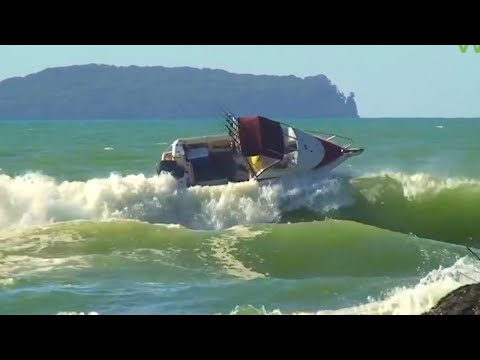 Boat has a lucky escape crossing river bar NZ