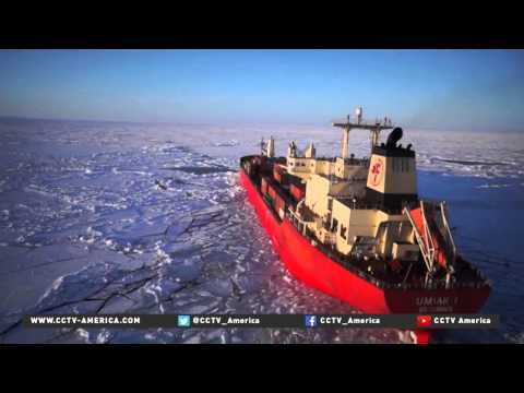 Ice breaking ships opening up passages to navigate the Arctic