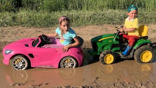 Sofia Ride On Car Toy and stuck in the mud! Max helps on the Tractor