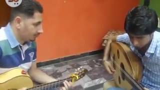 عزف على العود والغيتار