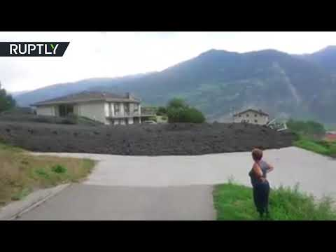 Massive Mudslide: Huge torrent of rocks and mud hits Swiss village