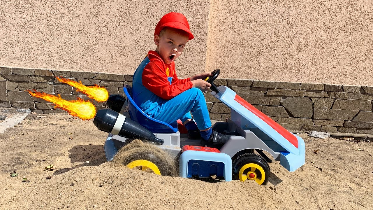Power Wheels Mario car stuck in the sand - Tractor hurry up to help