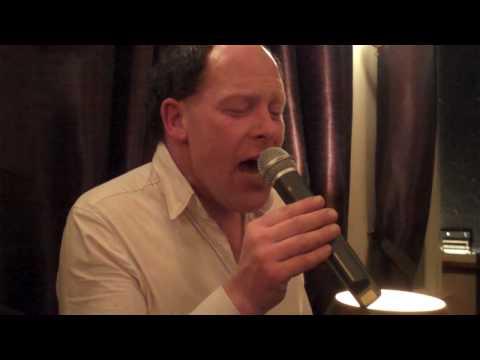 "Karaoke Kris singing ""No Woman, No Cry"" by Bob Marley"