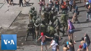 Police Clash with Protesters During International Women's Day March in Santiago, Chile