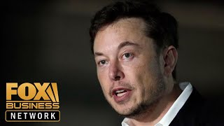 Tesla CEO Elon Musk touts robot cars amid sales slump