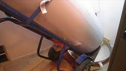 How to install a water heater drain pan without crushing it
