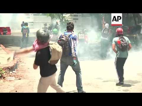 Venezuelan university students clash with police