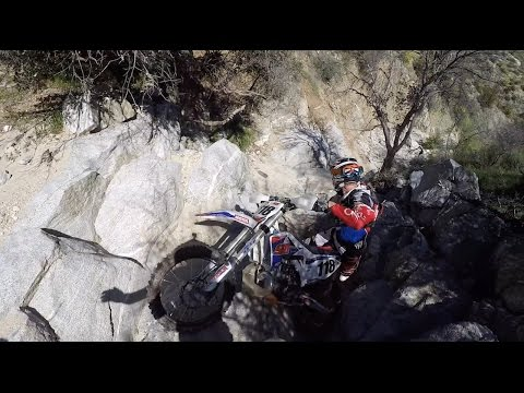 RIDER FALLS OFF HUGE ROCK CLIFF!!! (extreme enduro fail)